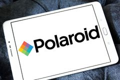 Polaroid Corporation logo. Logo of Polaroid Corporation on samsung tablet. Polaroid is an American company that is a brand licensor and marketer of its portfolio Stock Image