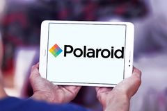 Polaroid Corporation logo. Logo of Polaroid Corporation on samsung tablet. Polaroid is an American company that is a brand licensor and marketer of its portfolio Stock Photo