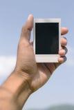 Polaroid in der Hand Stockfotografie