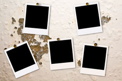 Polaroid films on damaged wall stock images