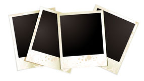 Polaroid foursome. Collection of four blank polaroid photographs fanned out Royalty Free Stock Photo