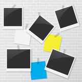 Photo frame and blank paper on brick wall Stock Photo