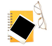 Polaroid frame and eye glasses Royalty Free Stock Image