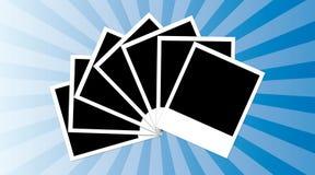 Polaroid frames. Seven polaroid frames isolated on a blue background Stock Photos
