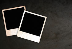 Polaroid frames. Two old polaroid frames on dark background royalty free illustration