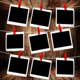 Polaroid frames hanging on rope Royalty Free Stock Images