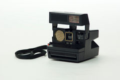 Polaroid Instant Camera. An old clean polaroid instant photographic camera Royalty Free Stock Image