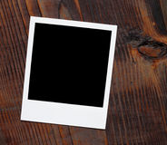 Polaroid instant photo frame. On old wood table Stock Photo
