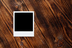 Polaroid instant photo frame. On old wood table Royalty Free Stock Photography
