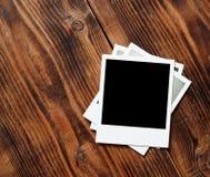 Polaroid instant photo frame. On old wood table Stock Photos
