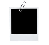 Polaroid instant photo frame with paperclip. Isolated on white Stock Image