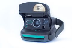 Polaroid 630 instant vintage camera on white background. Polaroid company was founded in 1937 in Cambridge stock images