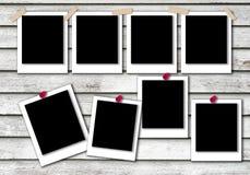 Polaroid- modell för fotoramar med bakgrundstextur royaltyfri fotografi