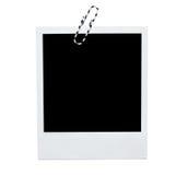 Polaroid- onmiddellijk fotokader met paperclip stock afbeelding