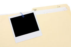 A polaroid photo and file folder Royalty Free Stock Photos