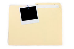 A polaroid photo and file folder Royalty Free Stock Images