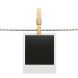 Polaroid photo frame with clothespin isolated on white backgroun. 3d render of polaroid photo frame with clothespin isolated on white background Stock Images