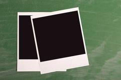 Polaroid photo frame on green chalkboard. Background Royalty Free Stock Image