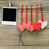 Polaroid photo frame and textile red hearts. Valentines Day. Concept Royalty Free Stock Images