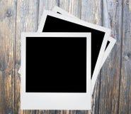 Polaroid photo frame. On wood background Stock Photos