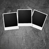 Polaroid photo frames on grunge wall Stock Photography