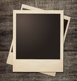 Polaroid photo frames on grunge wooden background stock photo