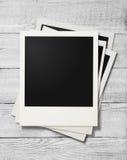 Polaroid photo frames on white wooden background royalty free stock photo