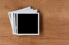 Polaroid photo frames on wooden background Royalty Free Stock Image
