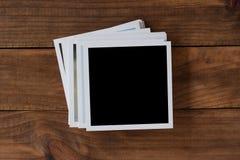 Polaroid photo frames on wooden background royalty free stock photography