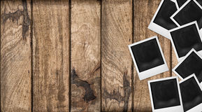 Polaroid photo frames wooden background. Wood table texture Royalty Free Stock Image
