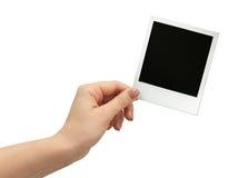 Polaroid photo in hand isolated Royalty Free Stock Photo