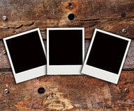 Polaroid photo on wood background Stock Photo