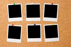 Polaroid photos on a corkboard Royalty Free Stock Photo