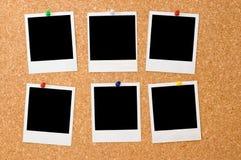 Polaroid photos on a corkboard. Six polaroid photos on a corkboard Royalty Free Stock Photo