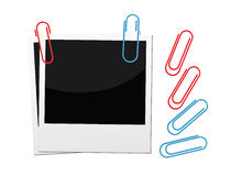 Polaroid photos with paper clips Stock Images