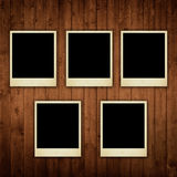Polaroid photos on wooden texture Royalty Free Stock Photography