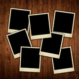 Polaroid photos on wooden texture royalty free stock photos