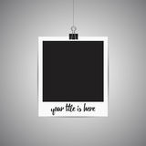 Polaroid picture hanging on the wall. Picture frame on gray. Pla Stock Image