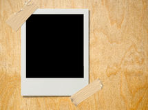 Polaroid on plywood Stock Photography