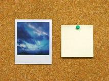Polaroid & post-it on corkboard. Polaroid photo & post-it on corkboard Stock Photography
