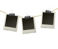 Polaroid frames on rope Royalty Free Stock Photo