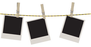Polaroid shots on clothesline Royalty Free Stock Photography