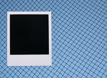 Polaroid sports netting. Sports netting background with old-fashioned polaroid blank picture Stock Photos