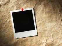 Polaroid style photo frame. S on cardboard Royalty Free Stock Image