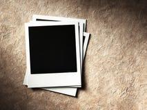 Polaroid style photo frame. S on cardboard Royalty Free Stock Photography