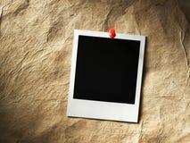 Polaroid style photo frame. S on cardboard Stock Images