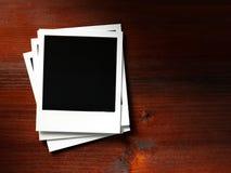 Polaroid style photo frame. Polaroid photo frame on wood background Stock Image