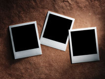 Polaroid style photo frames on vintage paper Stock Photography