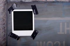Polaroid sujetada con cinta adhesiva Imagen de archivo libre de regalías