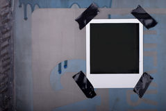 Polaroid sujetada con cinta adhesiva Imágenes de archivo libres de regalías